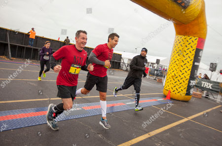 Released, Men's Health VP/Publisher Ronan Gardiner, VP/Editor in Chief Bill Phillips and host and celebrity fitness trainer Shaun T, during the 9th annual Men's Health Urbanathlon presented by Polo Red by Ralph Lauren, outside Soldier Field on Saturday, Oct. 18, 2014 in Chicago