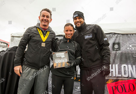 Men's Health VP/Publisher Ronan Gardiner, Classic Distance winner female division Angela Matthews with host and celebrity fitness trainer Shaun T, during the 9th annual Men's Health Urbanathlon presented by Polo Red by Ralph Lauren, outside Soldier Field on in Chicago