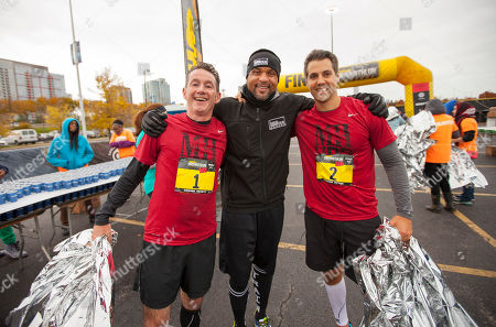 Men's Health VP/Publisher Ronan Gardiner, celebrity fitness trainer Shaun T and National Advertising Director Chris Peel during the 9th annual Men's Health Urbanathlon presented by Polo Red by Ralph Lauren, outside Soldier Field on in Chicago