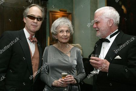 Stock Picture of Alice Munro, center, speaks with writer Russell Banks, right, and Aldon James, National Arts Club President, at a reception at the National Arts Club, in New York, before Munro receives the National Arts Club's 37th Annual Medal of Honor for Literature
