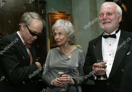 Stock Image of Alice Munro, center, speaks with writer Russell Banks, right, and Aldon James, National Arts Club President, at a reception at the National Arts Club, in New York, before Munro receives the National Arts Club's 37th Annual Medal of Honor for Literature