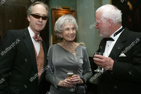Stock Photo of Alice Munro, center, speaks with writer Russell Banks, right, and Aldon James, National Arts Club President, at a reception at the National Arts Club, in New York, before Munro receives the National Arts Club's 37th Annual Medal of Honor for Literature