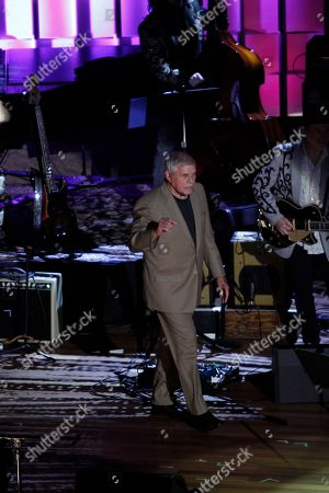 Tom T. Hall walks onto the stage at the 11th annual Americana Honors & Awards, in Nashville