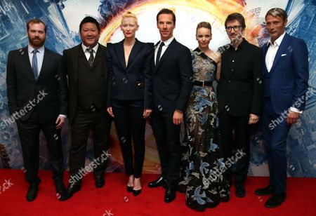 From left, producer Stephen Broussard, actors Benedict Wong, Tilda Swinton, Benedict Cumberbatch and Rachel McAdams, director Scott Derrickson and actor Mads Mikkelsen pose for photographers upon arrival at the launch event of the film 'Doctor Strange', in London