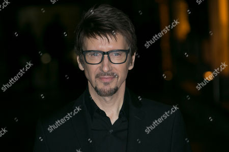 Director Scott Derrickson poses for photographers upon arrival at the launch event of the film 'Doctor Strange', in London