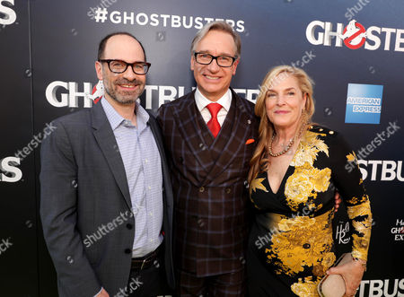 President of Sony Pictures Motion Picture Group Doug Belgrad, Paul Feig, and Laurie Feig are seen at the Los Angeles Premiere of Columbia Pictures' Ghostbusters at TCL Chinese Theatre, in Los Angeles