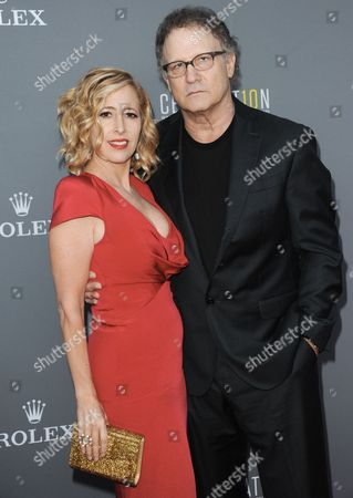 Kimberly Shlain, left, and Albert Brooks arrive at the LA Philharmonic's Walt Disney Hall 10th Anniversary Celebration at Walt Disney Concert Hall on in Los Angeles