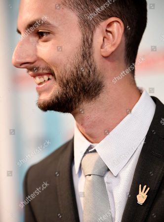 """Wesley Elder, a cast member in """"The Matchbreaker,"""" wears a pin referring to the favorite gesture of the late cast member Christina Grimmie at the premiere of the film at the ArcLight Cinerama Dome, in Los Angeles. Grimmie, a singer on the television singing competition series """"The Voice,"""" was shot and killed while signing autographs and meeting fans following a concert in June in Orlando, Fla"""