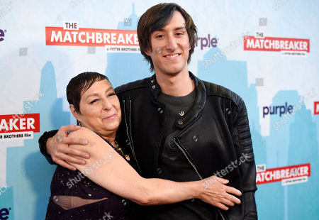 """Tina Grimmie, left, and Marcus Grimmie, the mother and brother of the late cast member Christina Grimmie, embrace at the premiere of the film, """"The Matchbreaker,"""" at the ArcLight Cinerama Dome, in Los Angeles. Grimmie, a singer on the television singing competition series """"The Voice,"""" was shot and killed while signing autographs and meeting fans following a concert in June in Orlando, Fla"""