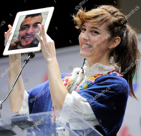 """Maria Barracuda of Mexican pop band Jotdog is joined by her partner in the group Jorge """"La Chiquis"""" Amaro via iPad to announce nominations for The XIII Annual Latin Grammy Awards at the Belasco Theater, in Los Angeles. The show will be held on Nov. 15 in Las Vegas"""
