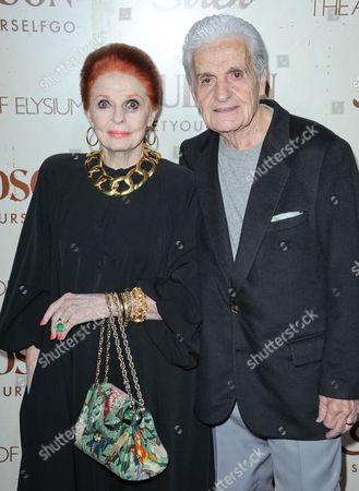 Carole Cook, left, and Tom Troupe arrive at The Art of Elysium's 5th Annual Genesis at Siren Cube on in Los Angeles