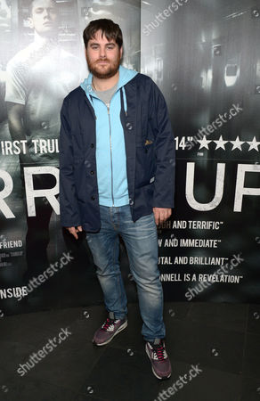 """Piers Aggett arrives at the UK Screening of """"Starred Up"""" at Hackney Picture House in London on Tuesday, March. 18th, 2014"""