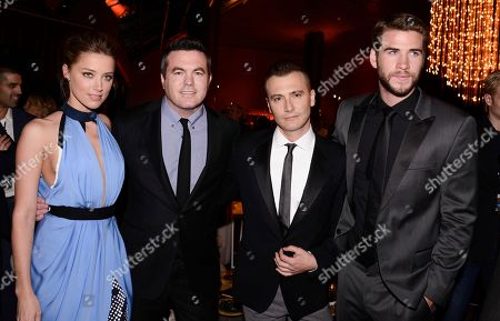 "From left to right, actress Amber Heard, Relativity Media President Tucker Tooley, director Robert Luketic, and actor Liam Hemsworth attend the after party of the US premiere of ""Paranoia"" at the DGA Theatre on in Los Angeles"