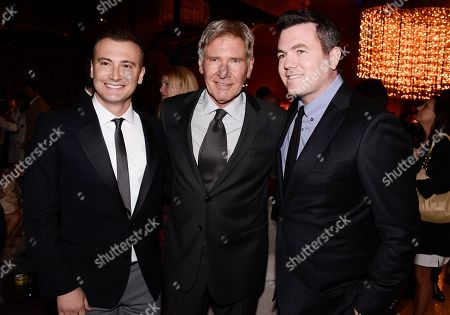 "From left to right, director Robert Luketic, actor Harrison Ford, and Relativity Media President Tucker Tooley attend the after party of the US premiere of ""Paranoia"" at the DGA Theatre on in Los Angeles"
