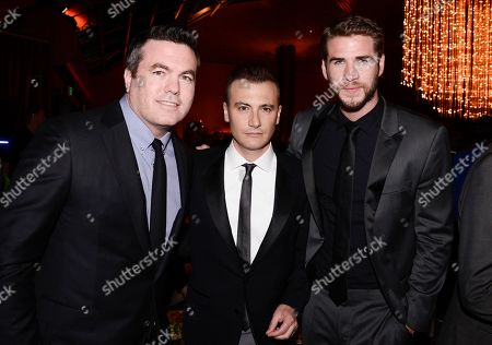 "Relativity Media President Tucker Tooley, left, director Robert Luketic, center, and actor Liam Hemsworth attend the after party of the US premiere of ""Paranoia"" at the DGA Theatre on in Los Angeles"