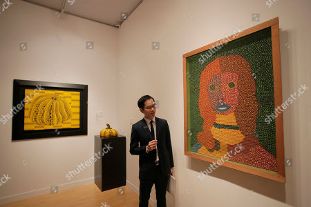 """A painting """"Shirley MacLaine"""" right, by Japanese artist Kusama Yayoi is displayed during a media preview for the Sotheby's Autumn Sales in Hong Kong, . The painting is expected to fetch US$2.31?3.2 million"""
