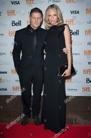 "Director Andrew Niccol and actress Rachel Roberts seen at the premiere of ""Good Kill"" at the Ryerson Theatre during the 2014 Toronto International Film Festival, in Toronto, Ontario"