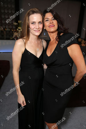 """Screenplay Writer Melisa Wallack and Producer Robbie Brenner seen at the 71st Annual Golden Globe Awards â?"""" NBC/Universal/Focus Features/E! Entertainment/Chrysler After Party on in Los Angeles"""