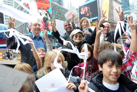 "Yoko Ono Lennon, center, joined by Hard Rock International President & CEO Hamish Dodds, right, WhyHunger Founder Bill Ayres, left, and Darryl ""DMC"" McDaniels, second left, and children from a local WhyHunger beneficiary attend the launch of Hard Rock's fifth annual IMAGINE THERE'S NO HUNGER campaign, in New York's Times Square. Proceeds from the campaign benefit WhyHunger and its grassroots partners combating childhood hunger and poverty worldwide. Diane Bondareff/Invision for Hard Rock/AP Images"