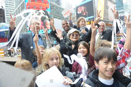 "Yoko Ono Lennon, center, joined by Hard Rock International President & CEO Hamish Dodds, right, WhyHunger Founder Bill Ayres, left, and Darryl ""DMC"" McDaniels, second left, and children from a local WhyHunger beneficiary attend the launch of Hard Rock's fifth annual IMAGINE THERE's NO HUNGER campaign, in New York's TImes Square. Proceeds from the campaign benefit WhyHunger and its grassroots partners combating childhood hunger and poverty worldwide"