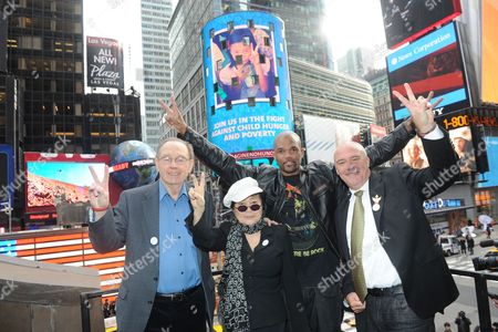 "Yoko Ono Lennon, second left, joined by Hard Rock International President & CEO Hamish Dodds, right, WhyHunger Founder Bill Ayres, left, and Darryl ""DMC"" McDaniels attend the launch of Hard Rock's fifth annual IMAGINE THERE's NO HUNGER campaign, in New York's TImes Square. Proceeds from the campaign benefit WhyHunger and its grassroots partners combating childhood hunger and poverty worldwide"