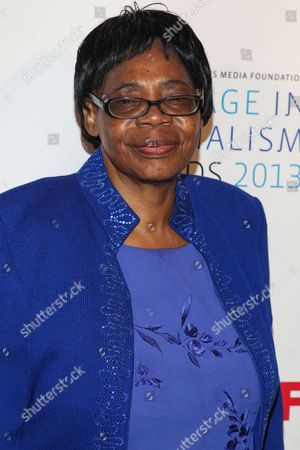 Stock Image of Lifetime Achievement Award winner Edna Machirori arrives at the International Women's Media Foundation's 2013 Courage in Journalism Awards at The Beverly Hills Hotel on in Beverly Hills, Calif