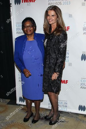 Stock Photo of Lifetime Achievement Award winner Edna Machirori (L) and journalist Maria Shriver arrive at the International Women's Media Foundation's 2013 Courage in Journalism Awards at The Beverly Hills Hotel on in Beverly Hills, Calif