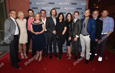 "Executive producer Mark Johnson, and from left, Adelaide Clemens, Luke Kirby, J. Smith-Cameron, Aden Young, Ray McKinnon, Sarah Barnett, president of SundanceTV, Abigail Spencer, Jake Austin Walker, Clayne Crawford, Bruce McKinnon and J.D. Evermore attend the premiere of SundanceTV's ""Rectify"" season 2, in Los Angeles"