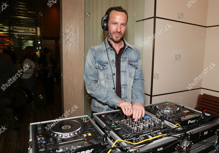 Stock Picture of DJ Jason Bentley poses during the Summer Food & Wine event benefiting Second Harvest Food Bank of Orange County held at Charlie Palmer at Bloomingdale's South Coast Plaza, in Costa Mesa, California