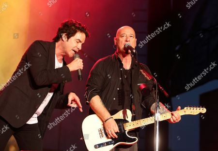 Pat Monahan, left, and Jimmy Stafford of the band Train perform in concert at the Delaware State Fair, in Harrington, Del