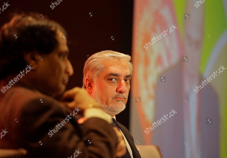 Afghanistan's Chief Executive Abdullah Abdullah, right, looks at Indian Commerce Minister Suresh Prabhu during an India-Afghanistan trade conference in New Delhi, India, . Abdullah is in the country for a three day India-Afghanistan trade and investment show