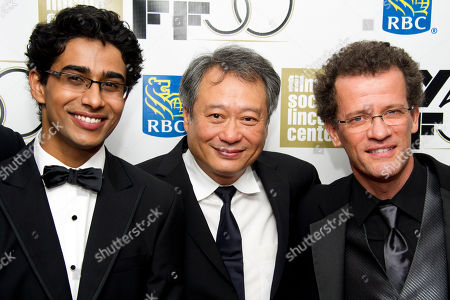 """Actor Suraj Sharma, from left, director Ang Lee and author Yann Martel attend the premiere of """"Life of Pi"""" at the 50th annual New York Film Festival opening night gala on in New York"""