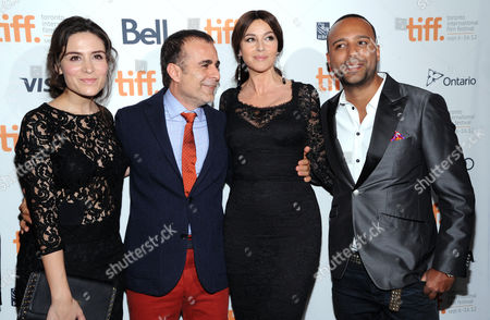 "From left, actress Belçim Bilgin, director/writer/producer Bahman Ghobadi, Monica Bellucci and actor Arash Labaf arrive at the premiere for ""Rhino Season"" during the Toronto International Film Festival on in Toronto"
