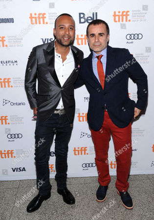 "Actor Arash Labaf, left, and director/writer/producer Bahman Ghobadi arrives at the premiere for ""Rhino Season"" during the Toronto International Film Festival on in Toronto"