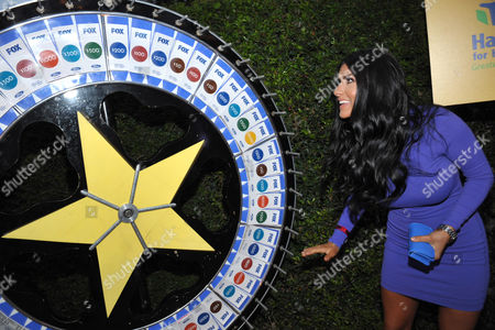Stock Image of MasterChef finalist Natasha Crnjac spins the wheel for charity at the 2013 FOX Fall Eco-Casino Party, on in Santa Monica, Calif