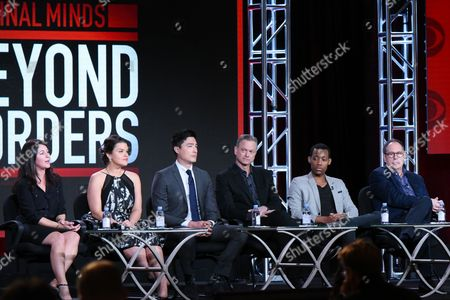 """Executive producer/creator Erica Messer, from left, actors Annie Funke, Daniel Henney, Gary Sinise, Tyler James Williams and executive producer Mark Gordon participate in the """"Criminal Minds: Beyond Borders"""" panel at the CBS 2016 Winter TCA, in Pasadena, Calif"""