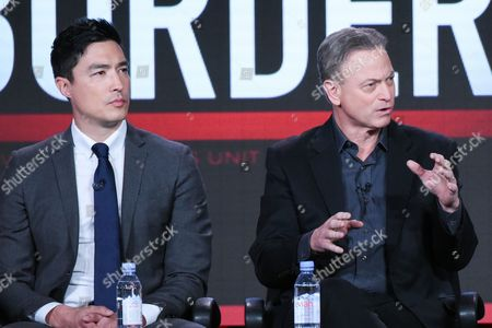 """Actors Daniel Henney, left, and Gary Sinise participate in the """"Criminal Minds: Beyond Borders"""" panel at the CBS 2016 Winter TCA, in Pasadena, Calif"""