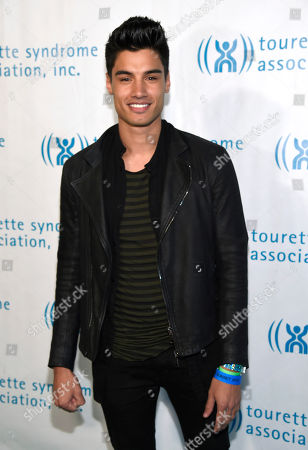 Stock Photo of Siva Kaneswaran, of the musical group The Wanted, arrives at the 2nd annual Hollywood Heals: Spotlight on Tourette Syndrome at the House of Blues, in West Hollywood, Calif