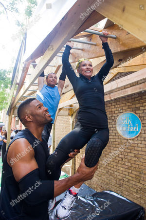 """Michael Strahan, left, Michael Gelman and Kelly Ripa compete in a Tough Mudder obstacle race on ABC's """"Live with Kelly and Michael"""" on in New York. The episode airs on Friday, Sept. 5"""