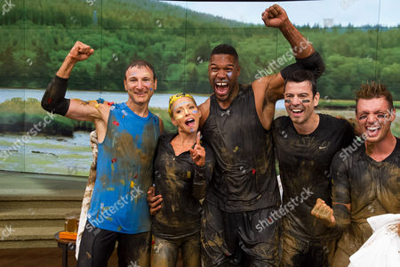 """Michael Gelman, left, Kelly Ripa, Michael Strahan, Jordan Knight and Nick Carter celebrate after competing in a Tough Mudder obstacle race on ABC's """"Live with Kelly and Michael"""" on in New York. The episode airs on Friday, Sept. 5"""