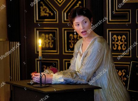 Stock Photo of British actress Gemma Arterton, who plays the Duchess, performs a scene by candle light from The Duchess of Malfi at Shakespeare's Globe theatre in central London, . Directed by Dominic Dromgoole, the play is part of the Sam Wanamaker Playhouse season