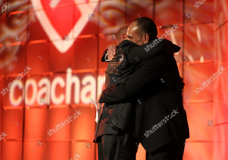 Dean Norris, left, and Nestor Serrano are seen onstage at the CoachArt Gala of Champions at The Beverly Hilton, in Beverly Hills, Calif