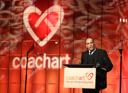 Nestor Serrano speaks onstage at the CoachArt Gala of Champions at The Beverly Hilton, in Beverly Hills, Calif