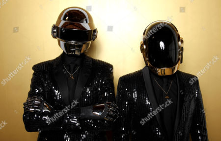 Thomas Bangalter, left, and Guy-Manuel de Homem-Christo, from the group Daft Punk pose for a portrait in Los Angeles. The Recording Academy announced, that Daft Punk will perform at the Grammy Awards show on Jan. 26, 2014