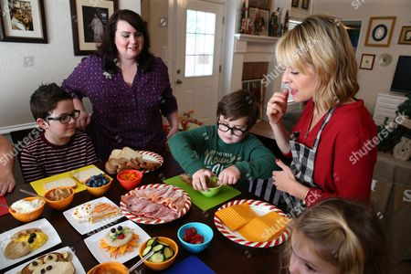Celebrity Chef Kelsey Nixon provides fun, sandwich making tips for the Tillotson Family and friends at Nature's Harvest bread's Kitchen Crash, in Forney, TX