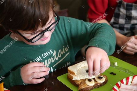 Oliver Tillotson makes his own sandwich art creation at Nature's Harvest® bread's Kitchen Crash with Celebrity Chef Kelsey Nixon, in Forney, TX