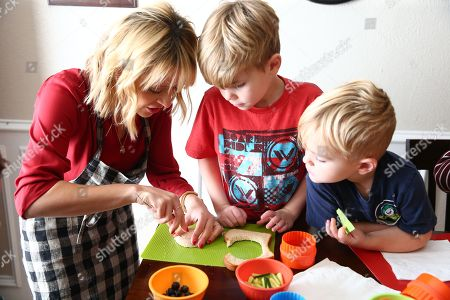 Celebrity Chef Kelsey Nixon works with Carter and Drake Mecham at Nature's Harvest® bread's Kitchen Crash at the Tillotson residence, in Forney, TX