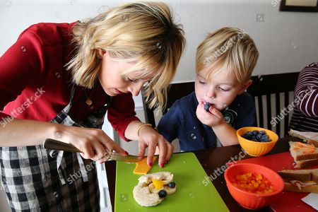 Celebrity Chef Kelsey Nixon works with Drake Mecham at Nature's Harvest® bread's Kitchen Crash at the Tillotson residence, in Forney, TX