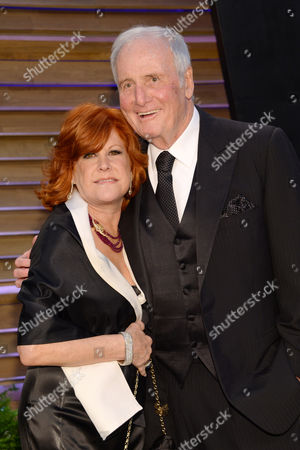 "Jane Morgan Jerry Weintraub and his longtime girlfriend Susie Ekins, left, attend the 2014 Vanity Fair Oscar Party in West Hollywood, Calif. Weintraub, the dynamic producer and manager who pushed the career of John Denver and produced such hit movies as ""Nashville"" and ""Ocean's Eleven,"" died, of cardiac arrest in Santa Barbara, Calif. He was 77"