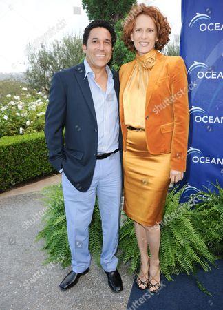 Oscar Nunez, left, and Ursula Whittaker arrive at the Oceana's Annual SeaChange Summer Gala on in Laguna Beach, Calif
